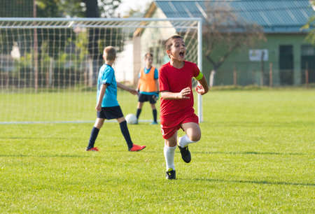Young Football soccer player celebrating after goal Stock fotó