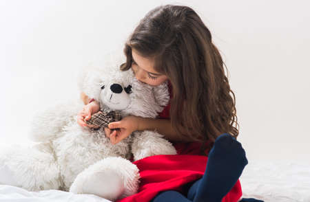 cheerfull: LIttle  girl with plush toy bear in the studio Stock Photo