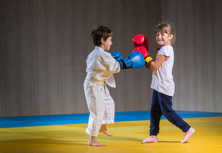 child sport: Young kids with boxing gloves training