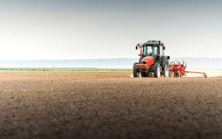 seed drill: Farmer seeding crops at field