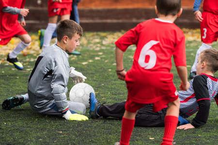 kicking: Boys kicking football on the sports field Stock Photo
