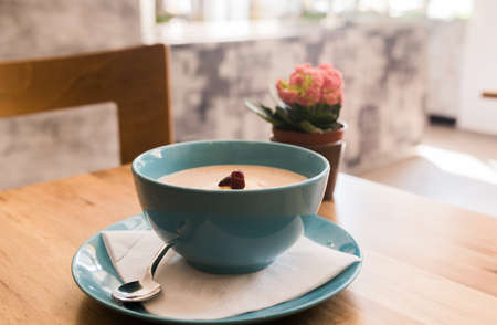 bannana: Delicious nutritious and healthy oatmeal with dried fruits on antique wood table
