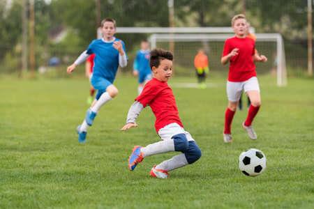 Kids soccer football - young children players match on soccer field Stok Fotoğraf