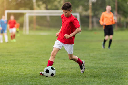 Kids soccer football - young children players match on soccer field 스톡 콘텐츠