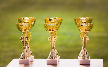 Beautiful champion golden trophy cups for winners in soccer  Stock Photo
