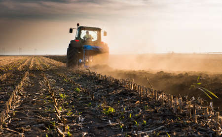 Tractor plowing fields  -preparing land for sowing Stok Fotoğraf - 88130394