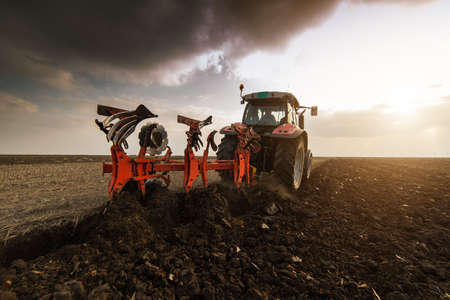 Tractor plowing fields -preparing land for sowing Banco de Imagens