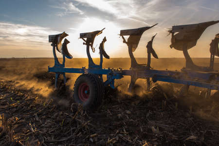 Tractor plowing fields -preparing land for sowing Stock Photo