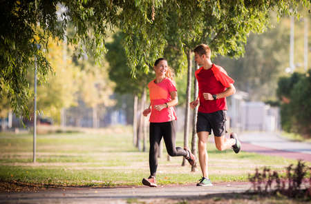 Sportive couple running in park
