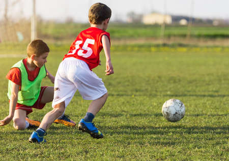 Young children player on the football match field Stock Photo