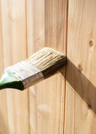 Paintin wooden surface with a brush Standard-Bild - 120588838
