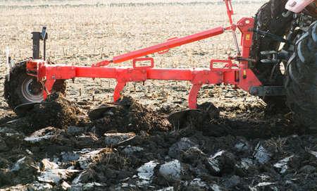 Tractors plowing stubble fields Reklamní fotografie - 120588843