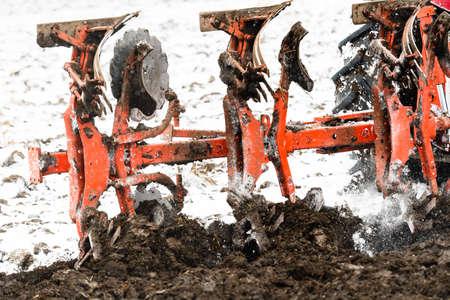 Tractors plowing stubble fields during winter Reklamní fotografie - 120588893