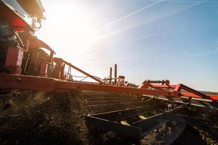 Tractors plowing stubble fields Reklamní fotografie - 120588930