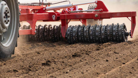 Tractors plowing stubble fields