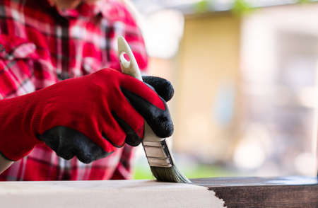 Painting wooden surface with a brush Stockfoto