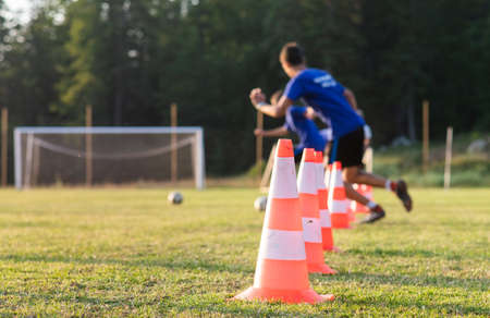 Kids Playing Football Soccer Game on Sports Field Foto de archivo - 129241607
