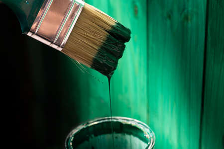 Painting wooden surface with a paintbrush