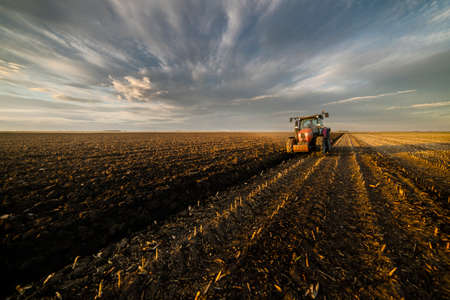 Tractor plowing fields -preparing land for sowing Stok Fotoğraf