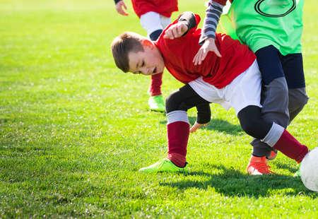 Boys play soccer on the field
