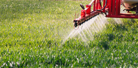 Nozzle of the tractor sprinklers sprayed. Stock fotó