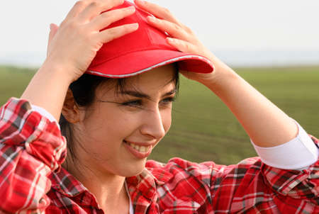 portrait of a young girl in a red cap in the wind