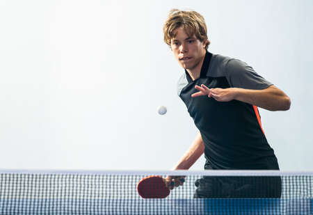 Teenager  playing   table tennis. Equipment, moving.