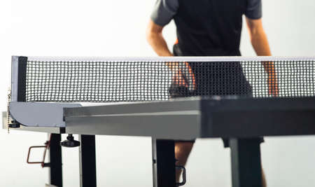 Tennis table concept. focus on net and white ball