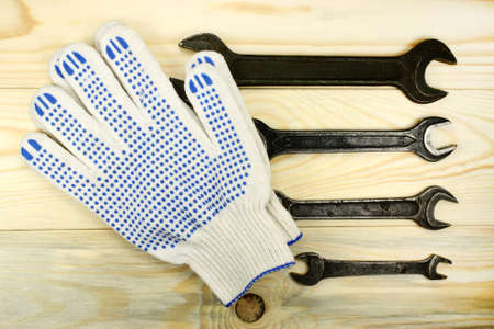 protective gloves: Open-end wrenches and protective gloves
