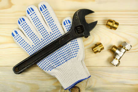 protective gloves: Adjustable spanner and protective gloves