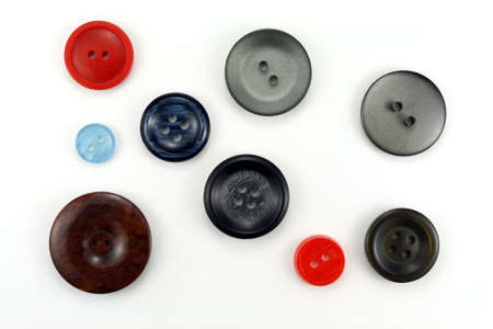large group of items: Buttons for sewing on a white background