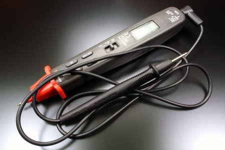 impedance: Pen type digital multimeter with probe