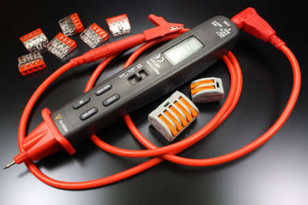 impedance: Pen type digital multimeter with terminals for connecting electric wires Stock Photo