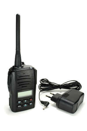 radio unit: Portable walkie-talkie with battery charger isolated on a white background Stock Photo