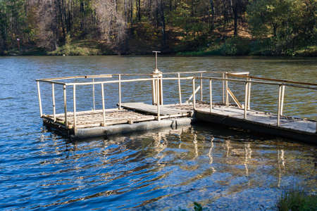 lack of water: Dam on a city pond in sunny autumn day Stock Photo