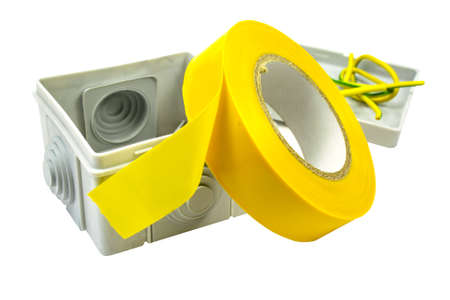 isolation white: Yellow insulating tape and terminal box isolated on a white background