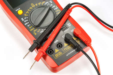 probes: Digital multimeter with probes on a white background