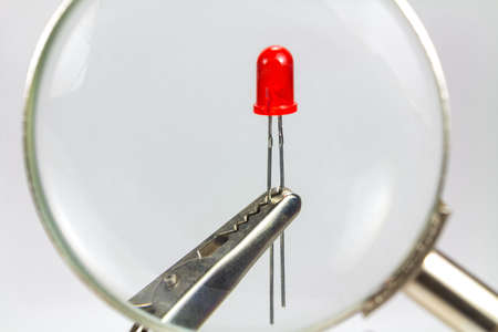 The image of the red LED diode through a magnifying glass