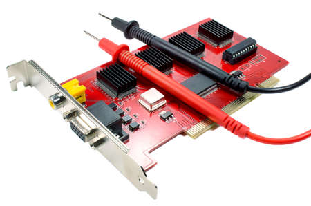 probes: DVR motherboard with the probes of the multimeter on a white background