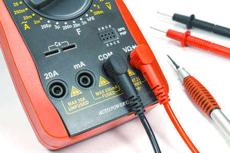 probes: Digital multimeter with probes and screwdriver on white background