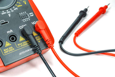 probes: Digital multimeter with attached probes on a white background