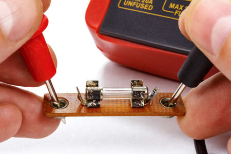 Test the fuse with a multimeter on a white background