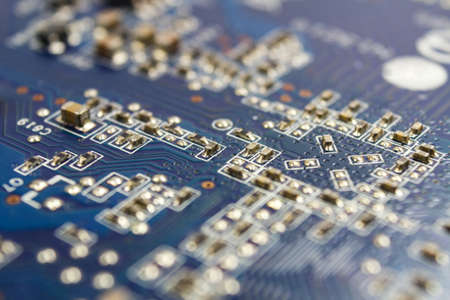 Fragment of the circuit board of the graphics card with installed electronic components Stock Photo