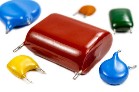Set of the used capacitors of various types on a white background