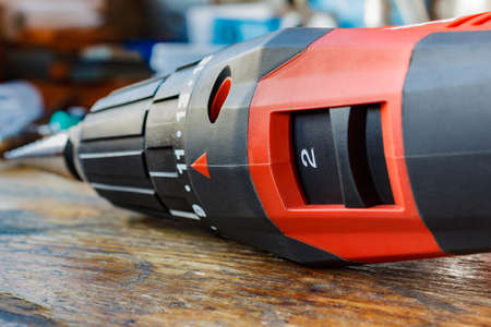 accumulator: Red screwdriver on a wooden table closeup Stock Photo