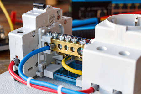 Electrical components on the mounting plate with the connected wires