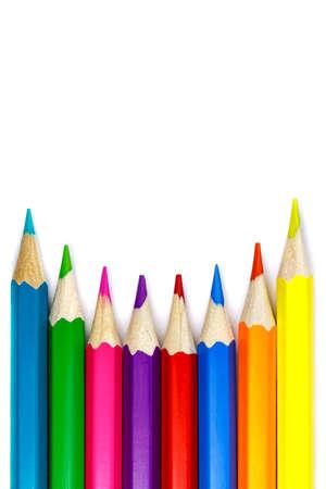 Set of colored pencils on a white background, concave arrangement