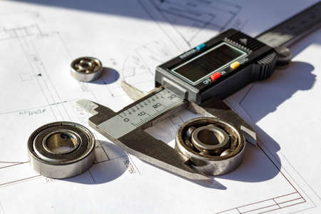 Measurement of the used ball bearings diameter by a digital caliper Stock Photo