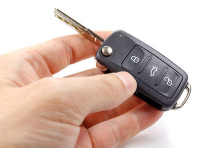 Opened ignition key with immobilizer in mans hands
