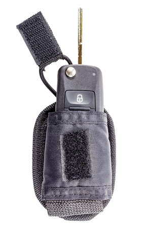 Opened ignition key in a storage pouch isolated on a white background